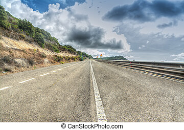 Country road under dramatic clouds