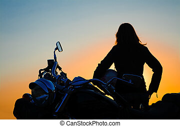 classic motorcycle and girl silhouette at sunset - classic...