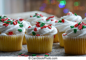 Christmas Cupcakes with Colorful Holiday Lights in Background