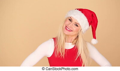Cute blond girl in a festive red Santa hat and matching top...