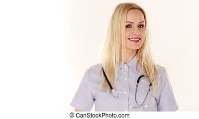 Smiling attractive female doctor or nurse with long blond...