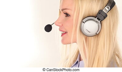 Young woman customer service advisor speaking to customer