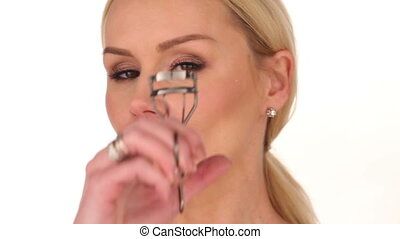 Close up Blond Woman Curling her Eyelashes - Close up Young...