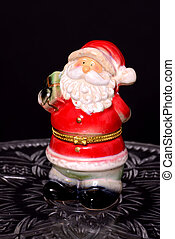 Santa ornament - Santa Claus ornament isolated over black...
