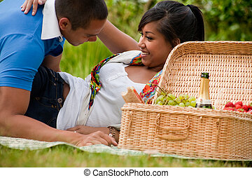 picknick temptation - Young happy asian couple enjoying...