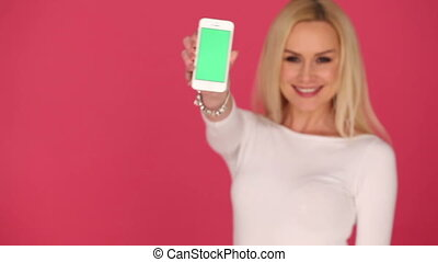 Attractive woman displaying a blank mobile phone -...