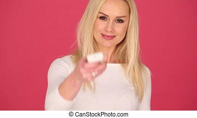 Pretty Woman in White Holding Remote Control