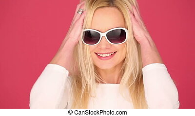 Vivacious woman in trendy sunglasses - Vivacious young blond...