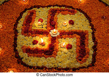 Floral Swastika - A background with a view of earthen lamps...