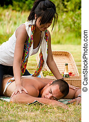 a massage for him - Young happy asian couple enjoying their...