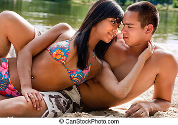 Beach couple in love - Young happy asian couple enjoying...
