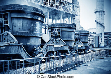 Steelworks landscape, train loaded with huge cans