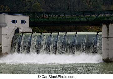dam with rushing water