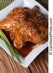 Chicken wings in honey glaze top view vertical - Chicken...