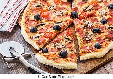 Pizza with ham, mushrooms and olives - Delicious pizza with...