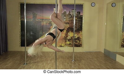 Girl performs complicated tricks on the pole - Alluring girl...