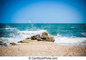 Big waves breaking on the shore with sea foam on Koh Samui