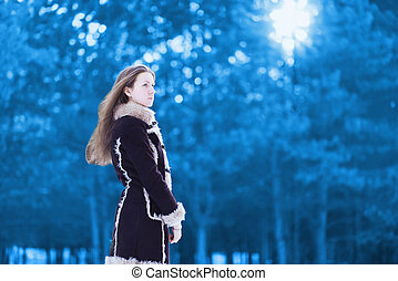 Beautiful woman outdoors in winter day
