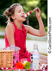 Eating a strawberry - Teenagers having a great time in the...