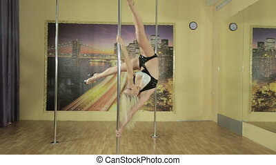 Girl performs complicated tricks on the pole - Attractive...