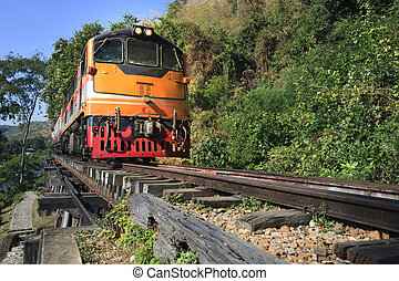 trains running on death railways track crossing kwai river...
