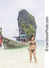 A girl on the beach - Beautiful thai girl standing on the...
