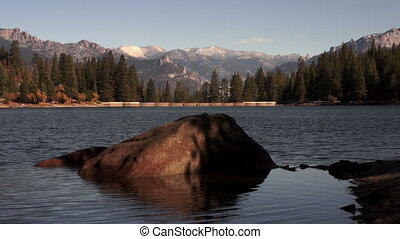 BIg Rock Shimmering Water Lake Hume - A quiet lake scene in...