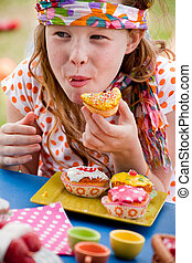 Happy eating cupcake girl - Teenagers having a great time in...