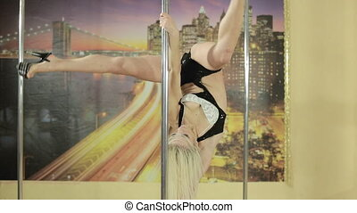 Girl performs different tricks on pole - Beautiful blonde...