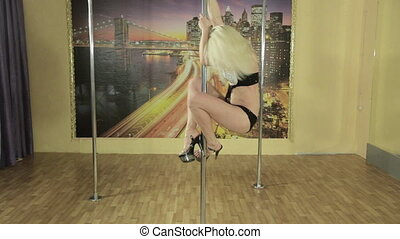 Pole dancer girl training in private gymnasium - Sensual...