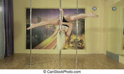 Beautiful slim girl doing amazing tricks on the pole -...