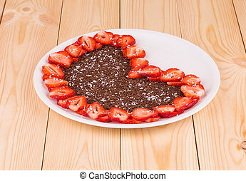 Strawberry cake with chocolate in heart shape