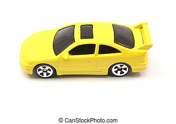 Yellow toy car coupe on a white background.