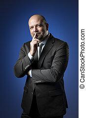 Thoughtful business man - Thoughtful businessman in dark...