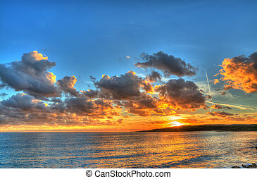 colorful sunset in Alghero coastline, Italy Processed for...
