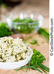 Portion of Herb Butter with Chives, Basil, Oregano, Parsley...