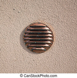 air intake in a rustic wall