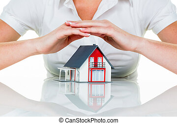 house is protected - a woman protecting your home and home....