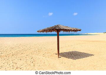 Beach scenery with parasol in Boavista, Cape Verde - Cabo...