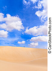 Sand dunes in Boavista desert with blue sky and clouds, Cape...