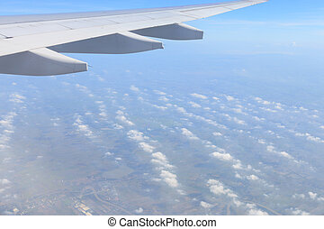 Airplane wing view from window beautiful sky