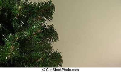 Christmas or New Year's  tree rotates on abstract background