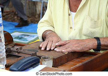 Handmade cigars - A man working on making the cigars