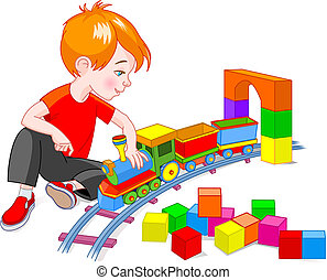 Boy with Train Set - Little boy playing with his wooden...