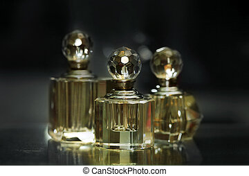 Bottles for perfumery with patches of light