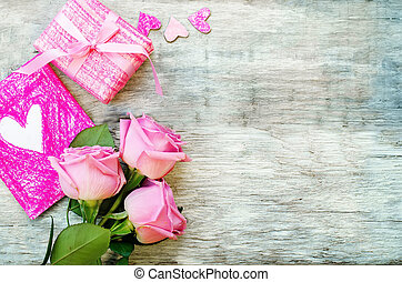 Valentines background with a gift, flower and card -...