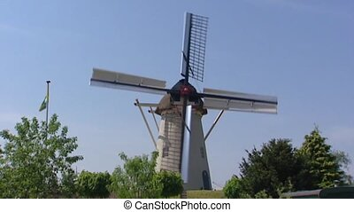 Dutch Windmill milling with open sails and Ten have sails...