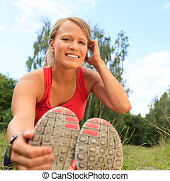 Happy Woman Runner Exercising and Stretching, summer nature outd