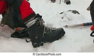 Hiker tying shoes - Mountaineer tying shoes
