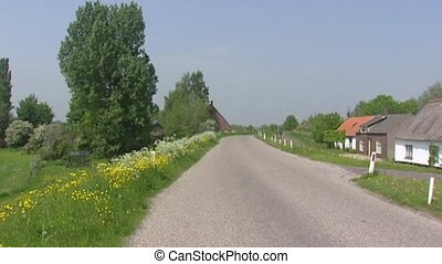 Ooijpolder river dike with roadside flora + pan workers...